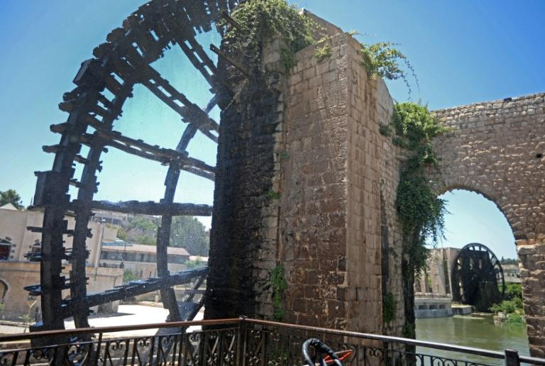 Two ancient water wheels, known as norias, along the Orontes river in the city of Hama in Syria (AFP Photo/LOUAI BESHARA)