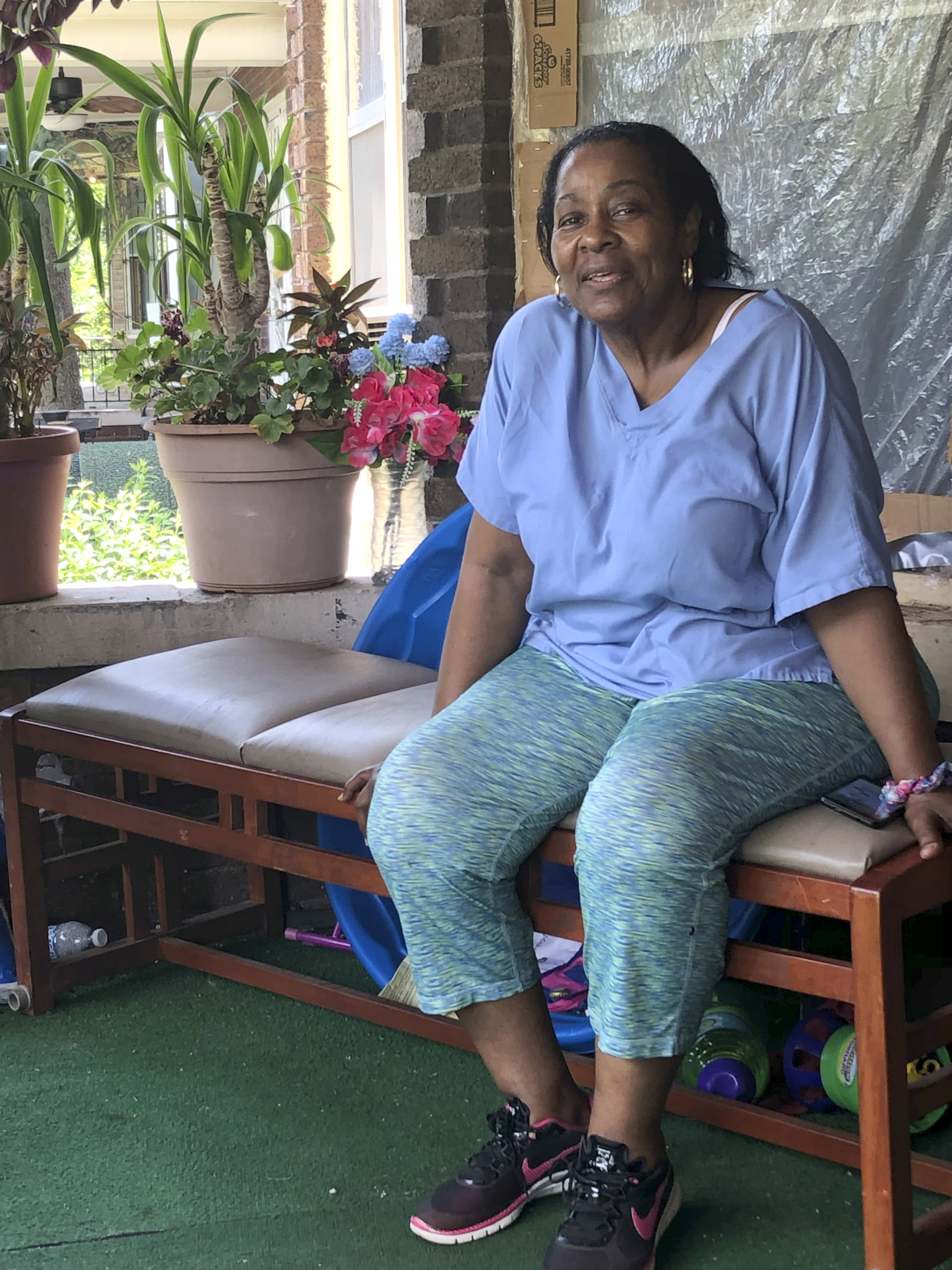 "Deloris Knight of Detroit, Mich., sits on her front porch, Wednesday, July 17, 2019, as she prepares for the heat wave that will descend upon Detroit and a wide section of the Midwest. Knight said she will keep the heat out of her Eastside Detroit home by keeping her doors and curtains closed while running the small window air conditioner in the living room. ""We have a couple of big fans. We have ceiling fans,"" Knight, 63, said while enjoying Wednesday's more comfortable 80-plus degree weather from her front porch. (AP Photo/Corey Williams)"