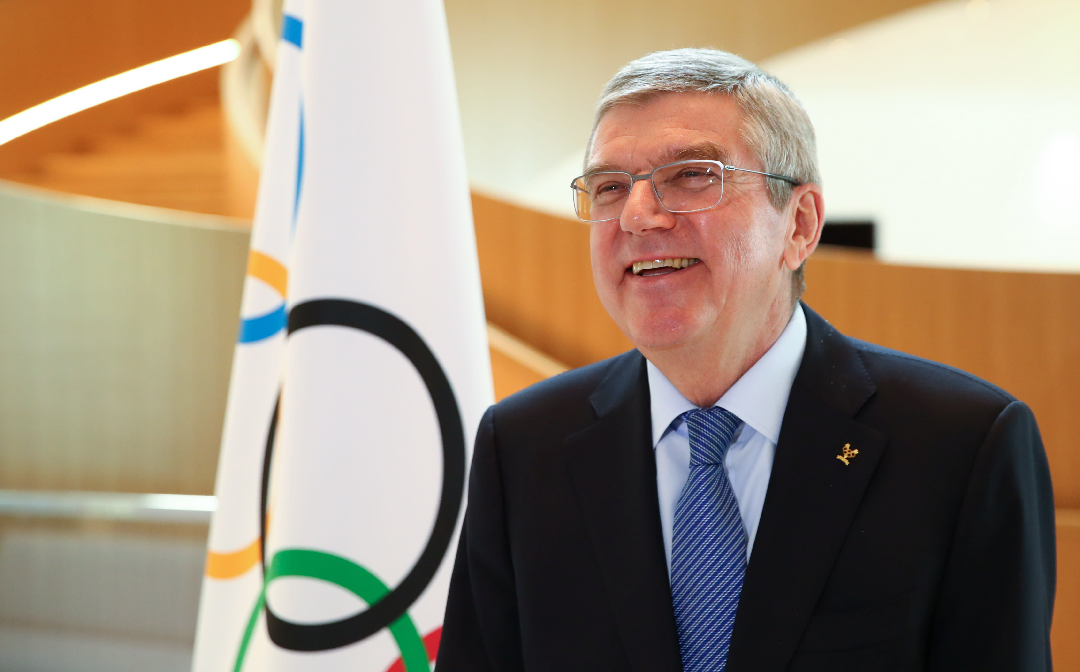 Thomas Bach, president of the International Olympic Committee (IOC), attends an interview after the decision to postpone the Tokyo 2020 Olympic Games because of the coronavirus disease (COVID-19) outbreak, in Lausanne, Switzerland, on Wednesday, March 25, 2020. (Denis Balibouse/Keystone via AP)