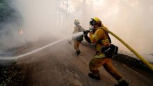 Firefighters battle to save communities from epic California fire