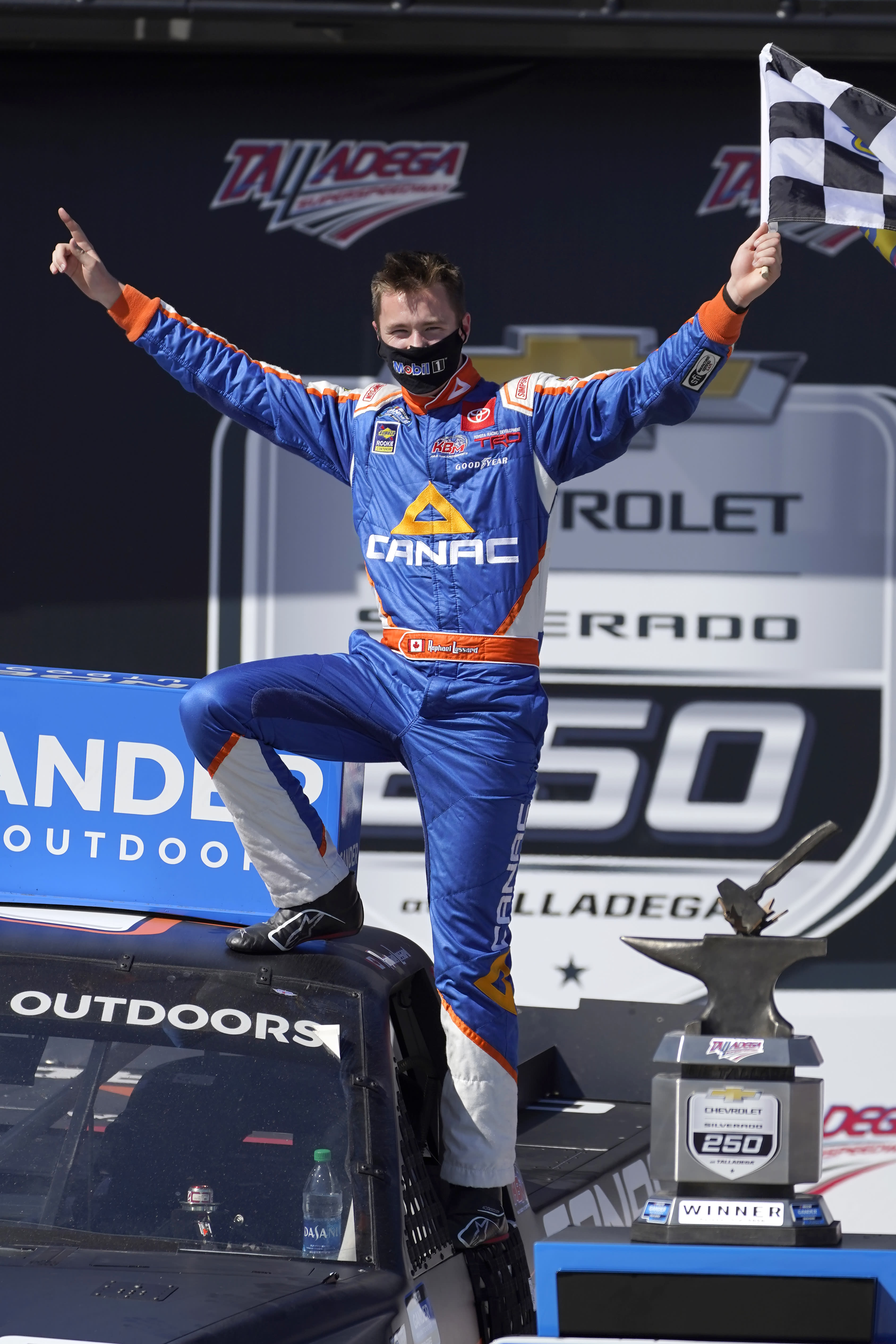Raphael Lessard celebrates in Victory Lane after winning the NASCAR Truck series auto race at Talladega Superspeedway, Saturday, Oct. 3, 2020, in Talladega, Ala. (AP Photo/John Bazemore)