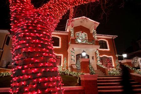 FILE PHOTO: A decorated house is seen at the Dyker Heights Christmas Lights in the Dyker Heights neighborhood of Brooklyn, New York City, U.S. on December 23, 2016. REUTERS/Andrew Kelly/File Photo