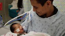 Husband of slain pregnant teen Marlen Ochoa-Lopez holds baby cut from wife's womb in heartbreaking photo