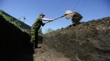 Fearing attack, Russian-backed rebels dig trenches in Ukraine
