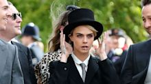 Cara Delevingne looks effortlessly cool in a tuxedo at the royal wedding