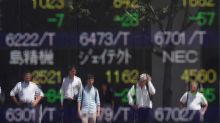 Asia shares tick higher as China cuts repo rate