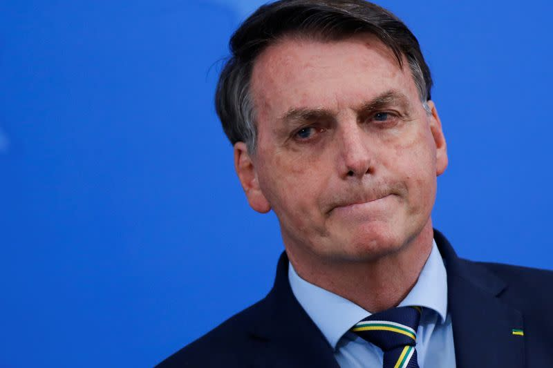 Brazil's Bolsonaro Abruptly Fires Health Minister for Urging Social Distancing