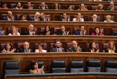 "Socialist deputies applaud after winning the vote in parliament on the Socialist's government's plans to exhume the remains of former dictator Francisco Franco from the giant mausoleum at ""The Valley of the Fallen"", in Madrid, Spain, September 13, 2018. REUTERS/Sergio Perez"