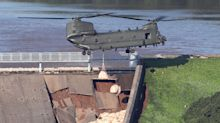 RAF Chinook drafted in to help save reservoir at risk of collapsing - as some residents refuse to leave nearby town