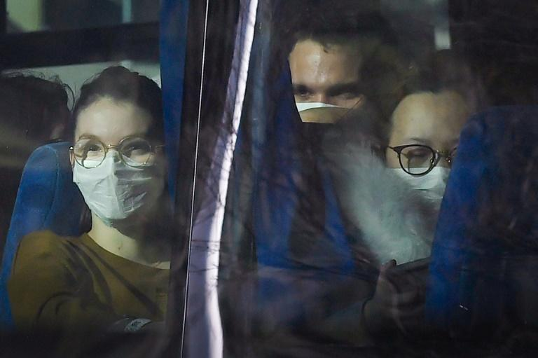 Passengers look on from a vehicle carrying French citizens evacuated from Wuhan, China, near Marseille, France on January 31, 2020