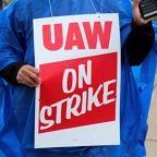UAW workers head for picket lines in first national strike against GM since 2007