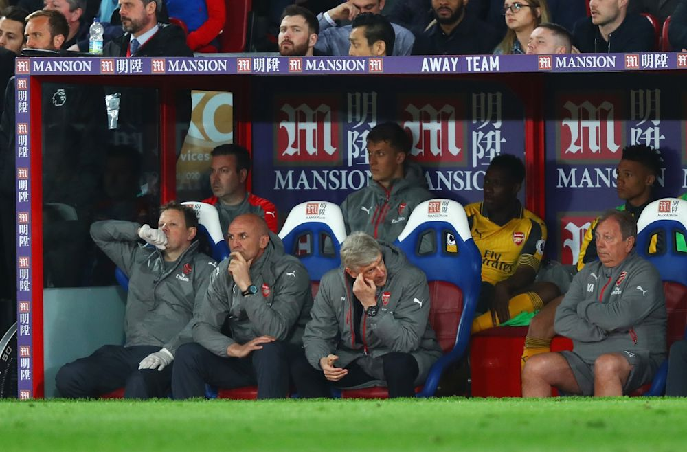 Arsene Wenger can barely watch as his Arsenal side fall apart