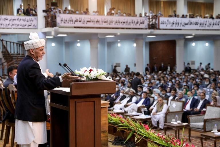 President Ashraf Ghani told the loya jirga gathering that peace talks could begin in days if the prisoners were freed