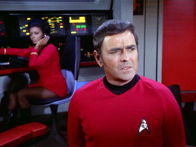 """LOS ANGELES - JANUARY 3: From left: Nichelle Nichols as Lieutenant Uhura and James Doohan as Chief Engineer Montgomery 'Scotty' Scott on the Star Trek: The Original Series episode, """"Whom Gods Destroy."""" Originally aired January 3, 1969. Image is a screen grab. (Photo by CBS via Getty Images)"""