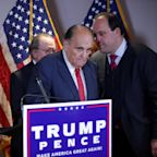 Trump adviser who was with Rudy Giuliani at press conference tests positive for coronavirus
