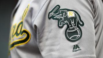 Flame-throwing fan shines in minor league debut