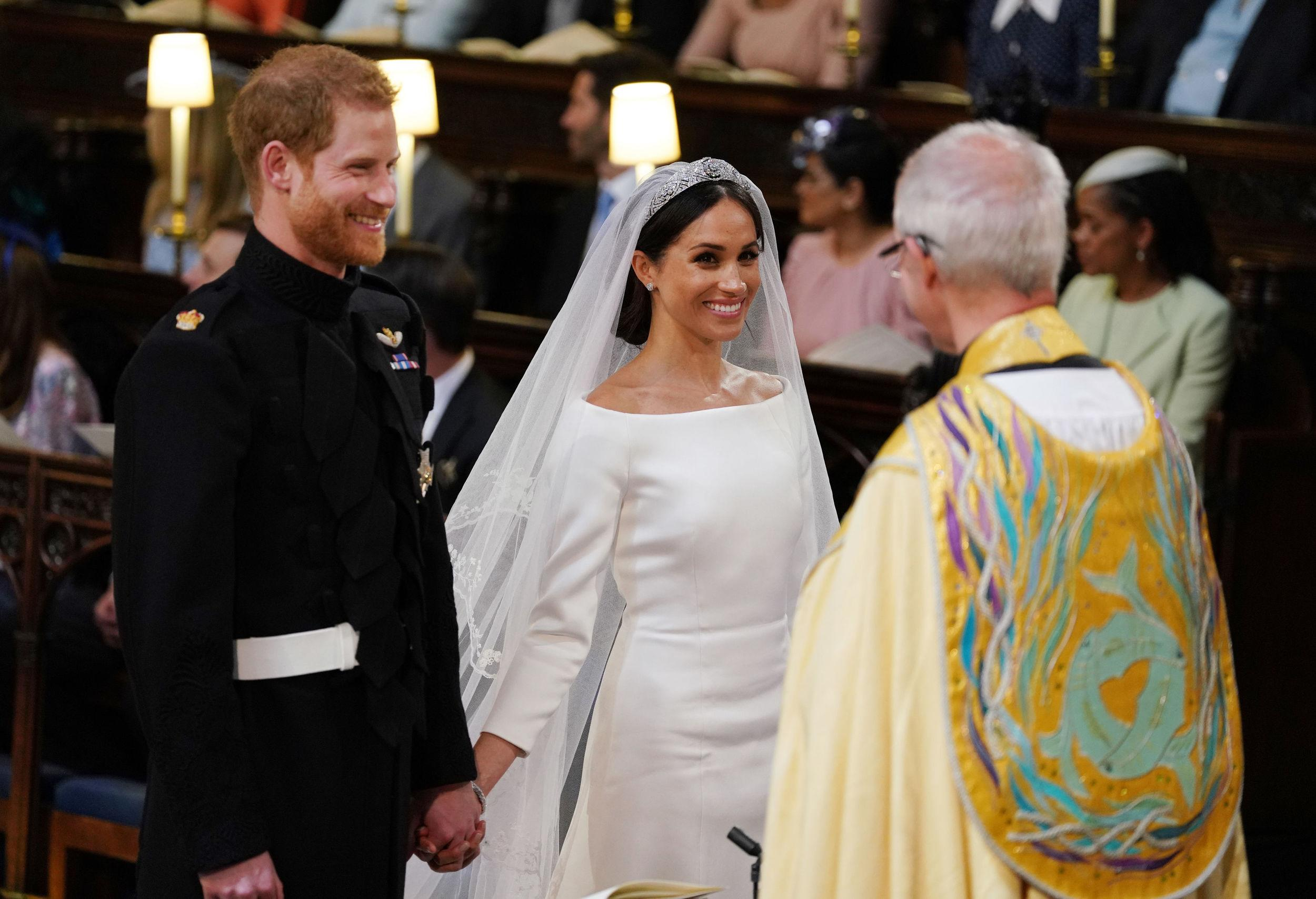 <p>Prince Harry and Meghan Markle during their wedding service, conducted by the Archbishop of Canterbury Justin Welby in St George's Chapel at Windsor Castle on May 19, 2018 in Windsor, England.</p>  <p>(Photo by Dominic Lipinski - WPA Pool/Getty Images)</p>