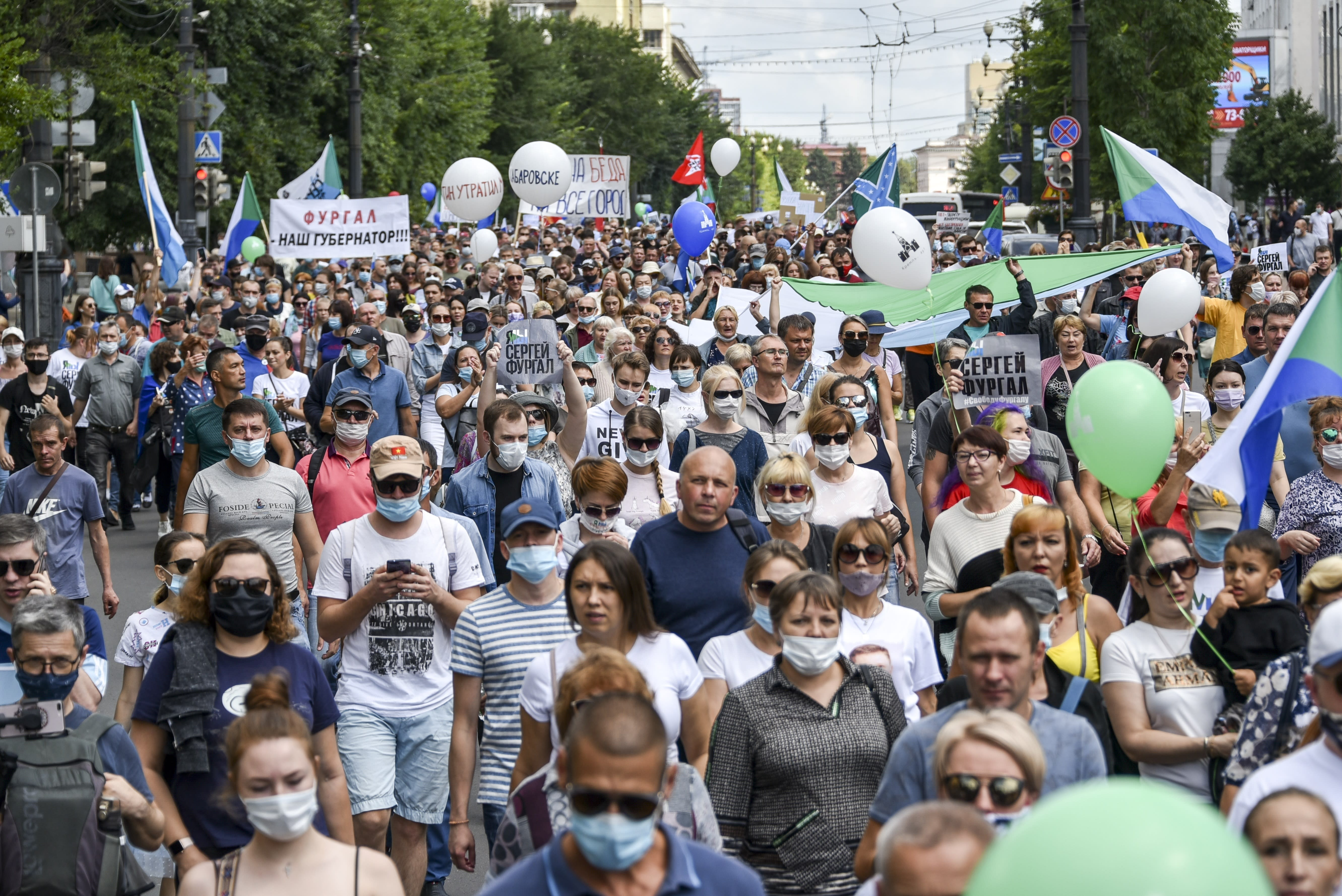 "People hold posters that read: ""I am, We are Sergei Furgal, Sergei Furgal our Governor"", during an unsanctioned protest in support of Sergei Furgal, the governor of the Khabarovsk region, in Khabarovsk, 6100 kilometers (3800 miles) east of Moscow, Russia, Saturday, Aug. 8, 2020. Thousands of demonstrators have again gathered in the major Russian Far East city of Khabarovsk to denounce the arrest of the region's governor a month ago. Sergei Furgal was arrested on suspicion of involvement in murders and taken to jail in Moscow. The estimated 3,000 demonstrators in Khabarovsk protested the charges and want him returned to the city for trial. (AP Photo/Igor Volkov)"
