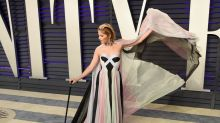 Selma Blair gets teary eyed as she triumphantly walks red carpet with a cane at Oscars party