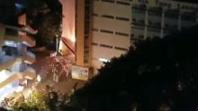 Manhunt launched after firebomb attack on Hong Kong school
