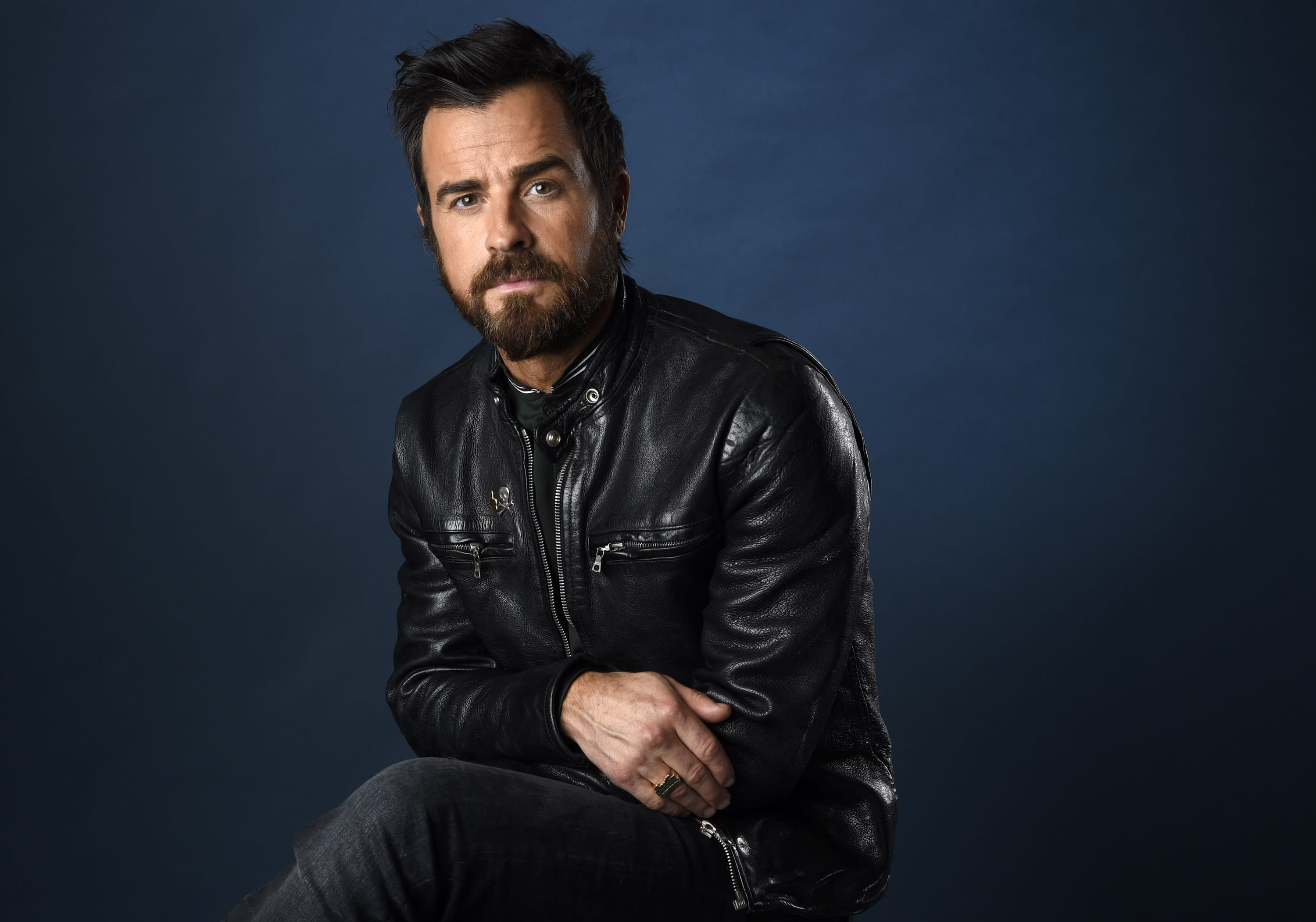"FILE - Justin Theroux poses for a portrait to promote the film ""The LEGO Ninjago Movie"" on day two of Comic-Con International on July 21, 2017, in San Diego. Theroux turns 49 on Aug. 10. (Photo by Chris Pizzello/Invision/AP)"