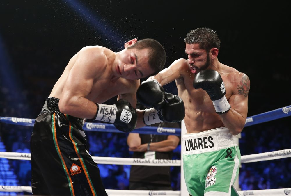 Jorge Linares of Barinas, Venezuela, right, trades punches with Nihito Arakawa of Musashino, Japan during their lightweight boxing match, Saturday, March 8, 2014, at The MGM Grand Garden Arena in Las Vegas. Linares won by unanimous decision