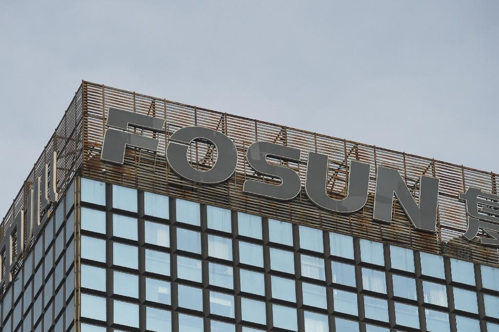 Shares related to Fosun Group, one of China's biggest private companies and owner of Club Med, slump after a turbulent week in which it announced a profit surge but also the resignation of its CEO and co-founder (AFP Photo/GREG BAKER)