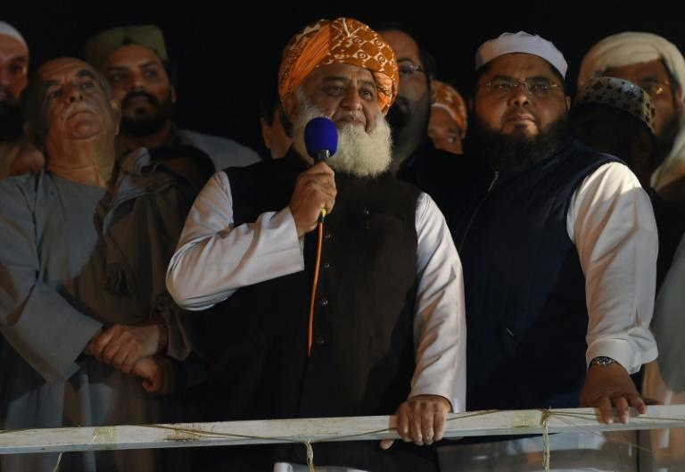 """Firebrand cleric Maulana Fazlur Rehman addresses supporters during an anti-government """"Azadi (Freedom) March"""" in Islamabad on November 3, 2019 -- he has vowed to pursue his protest against Prime Minister Imran Khan (AFP Photo/FAROOQ NAEEM)"""