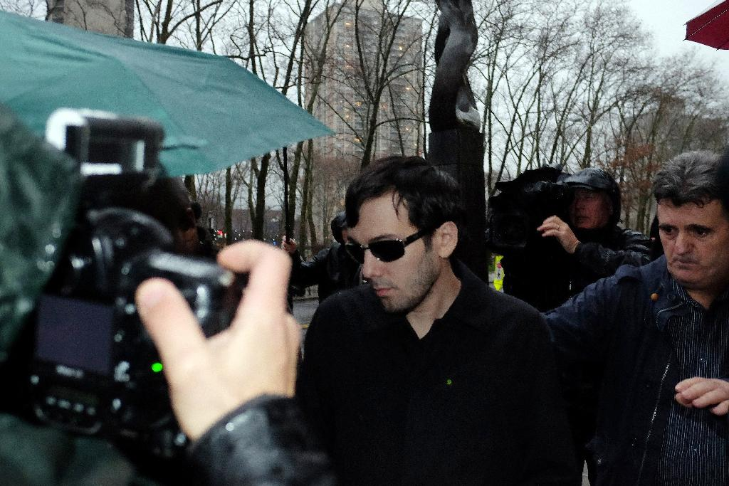 "Martin Shkreli (C), pictured on December 17, 2015, threatened to edit out contributions on ""Once Upon a Time in Shaolin"" by Ghostface Killah after the Wu-Tang member insulted him (AFP Photo/Jewel Samad)"