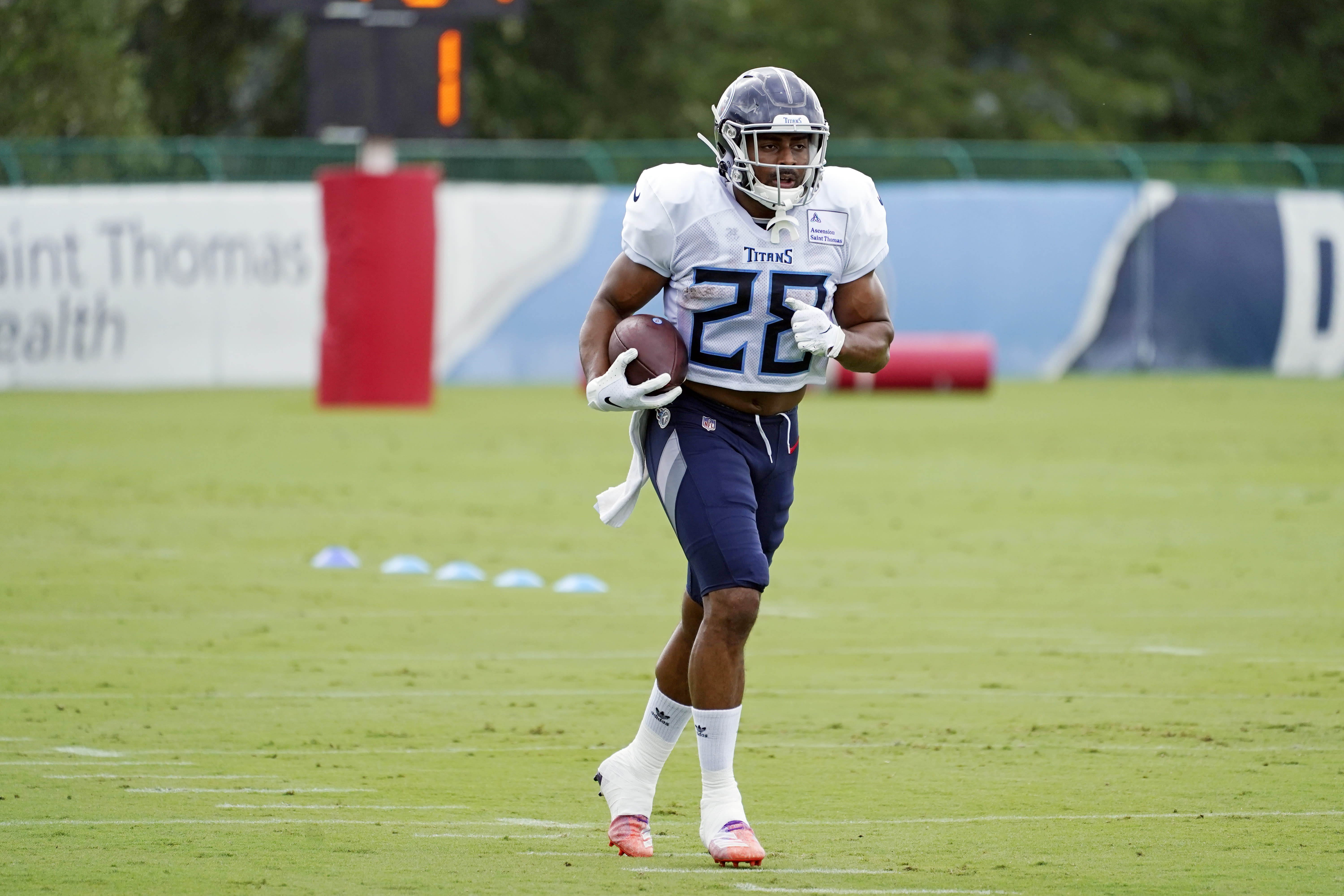 Tennessee Titans running back Jeremy McNichols takes part in NFL football training camp Friday, Aug. 28, 2020, in Nashville, Tenn. (AP Photo/Mark Humphrey, Pool)