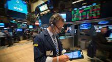 Wall Street: le Dow Jones, à un record, salue la Fed et le Congrès