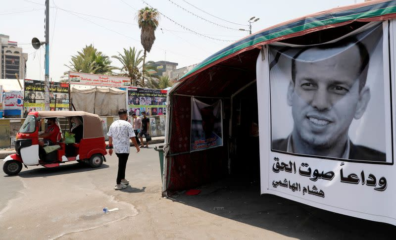 FILE PHOTO: A poster depicting the former government advisor and political analyst Hisham al-Hashemi, who was killed by gunmen is seen at the Tahrir Square in Baghdad