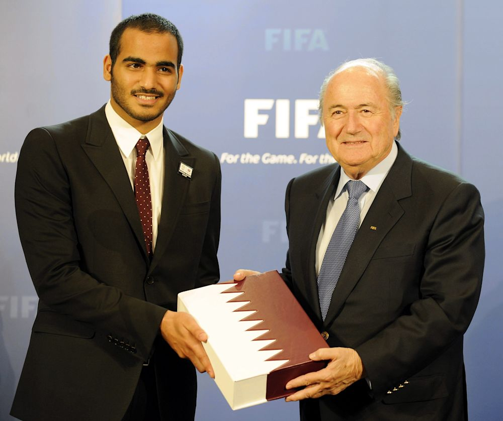 In this Friday, May 14, 2010 file photo, Sheikh Mohammed bin Hamad bin Khalifa AI Thani, left, Chairman of Qatar 2022 Bid Committee hands over the bid to host the FIFA soccer World Cup 2022 to FIFA President Josef S. Blatter, right, in Zurich, Switzerland. FIFA secretary general Jerome Valcke says the 2022 World Cup in Qatar will not be held in June or July because of the Gulf country's summer heat