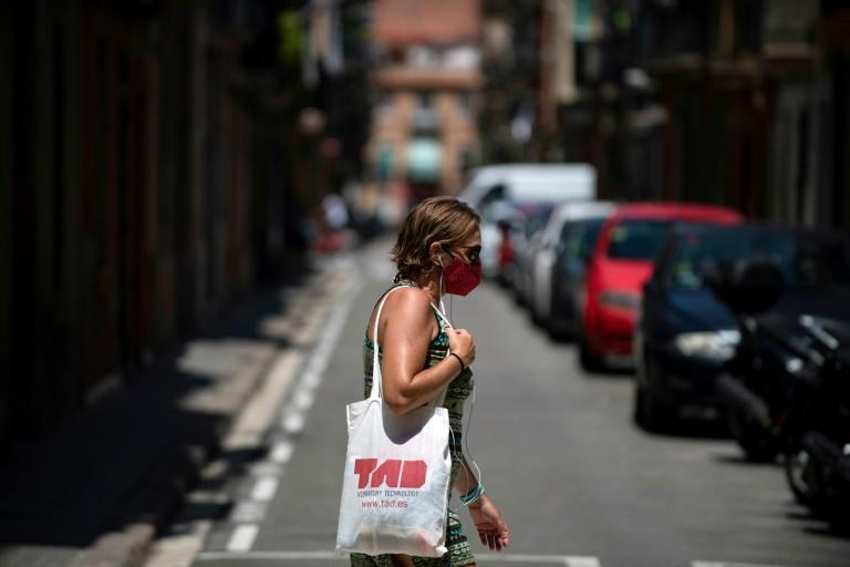Few tourists were seen walking around Spain's second city (AFP Photo/Josep LAGO)