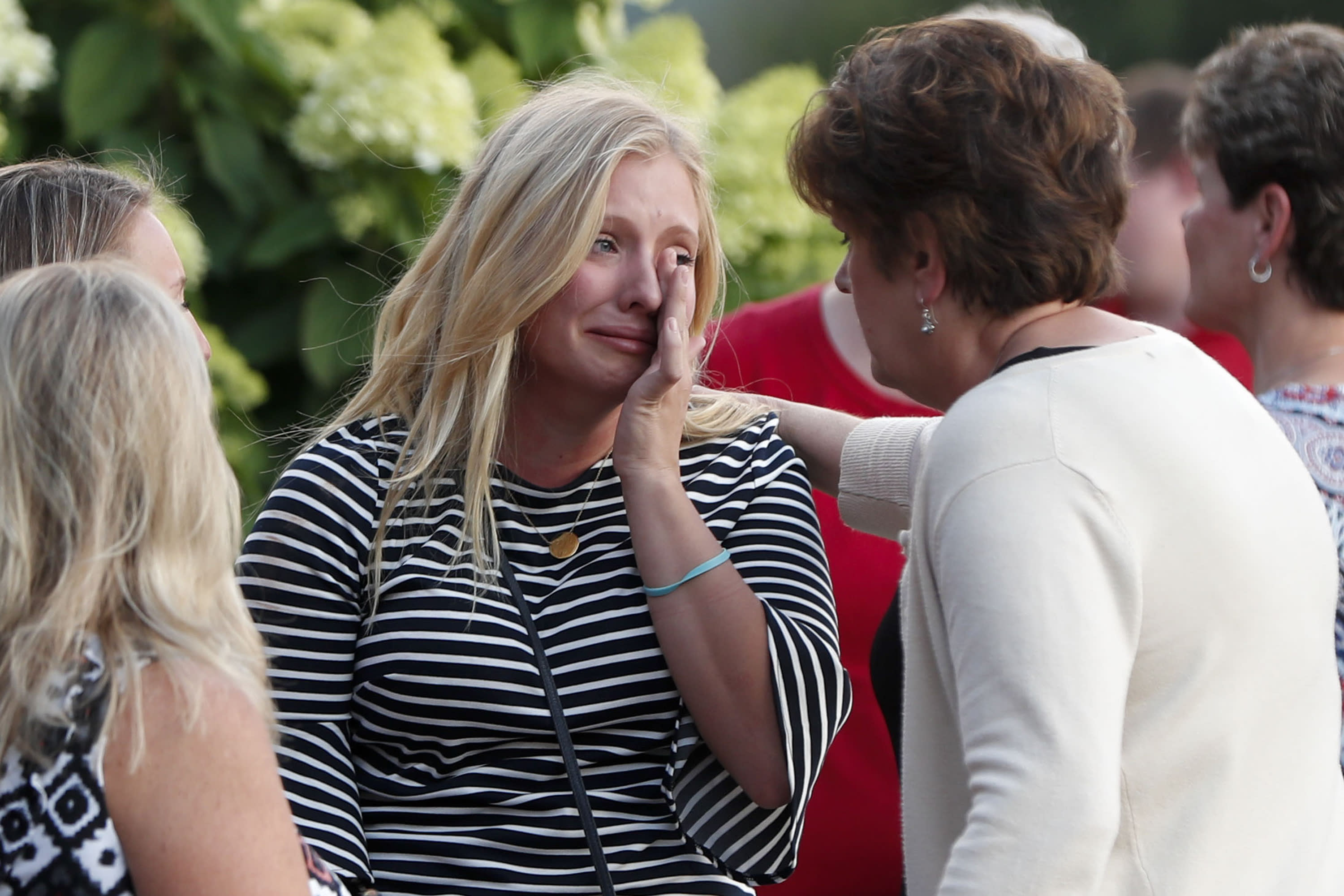 Loved ones mourn shooting victims as policy debate rages