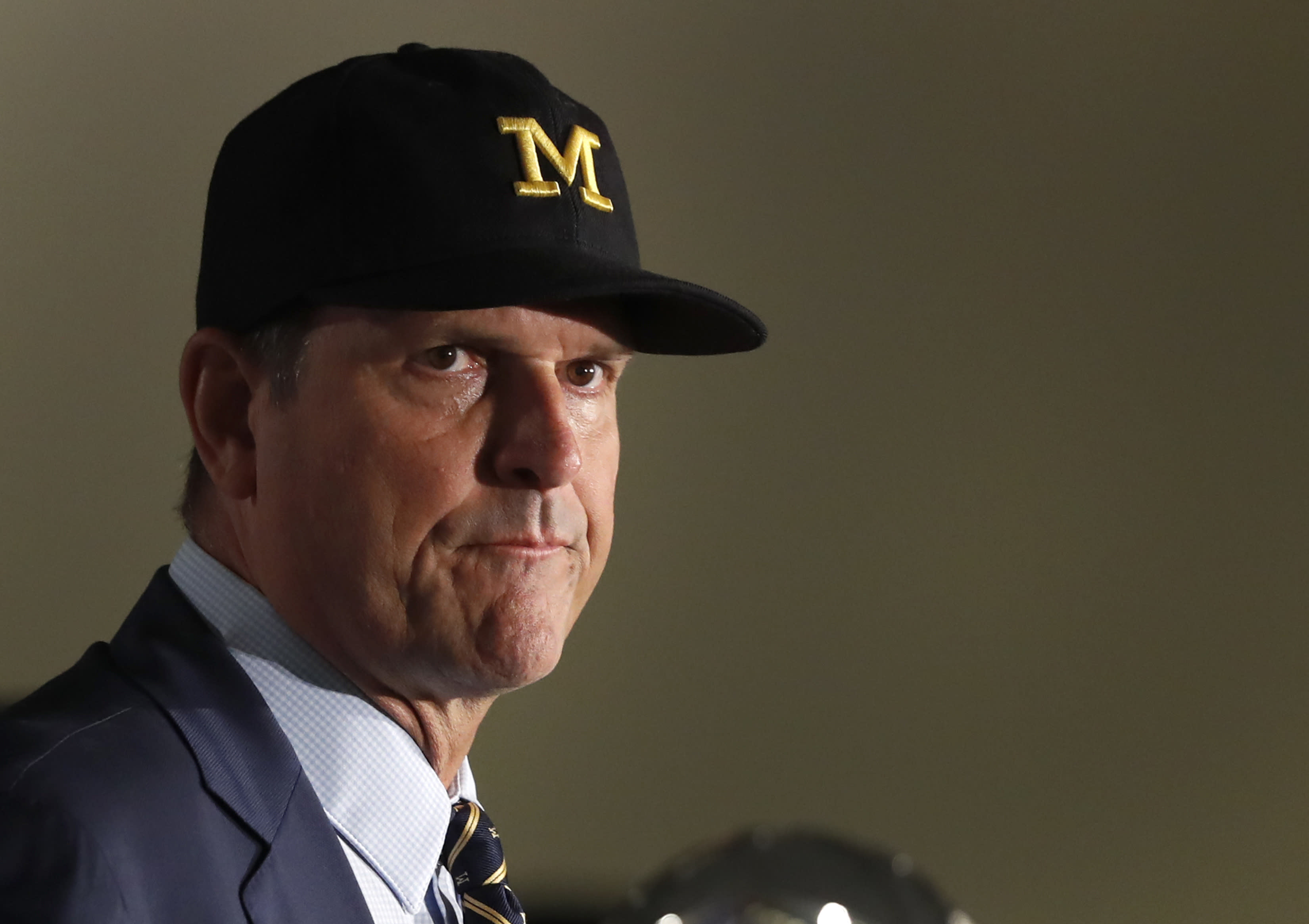 Michigan head coach Jim Harbaugh listens to a question during the Big Ten Conference NCAA college football media days Friday, July 19, 2019, in Chicago. (AP Photo/Charles Rex Arbogast)