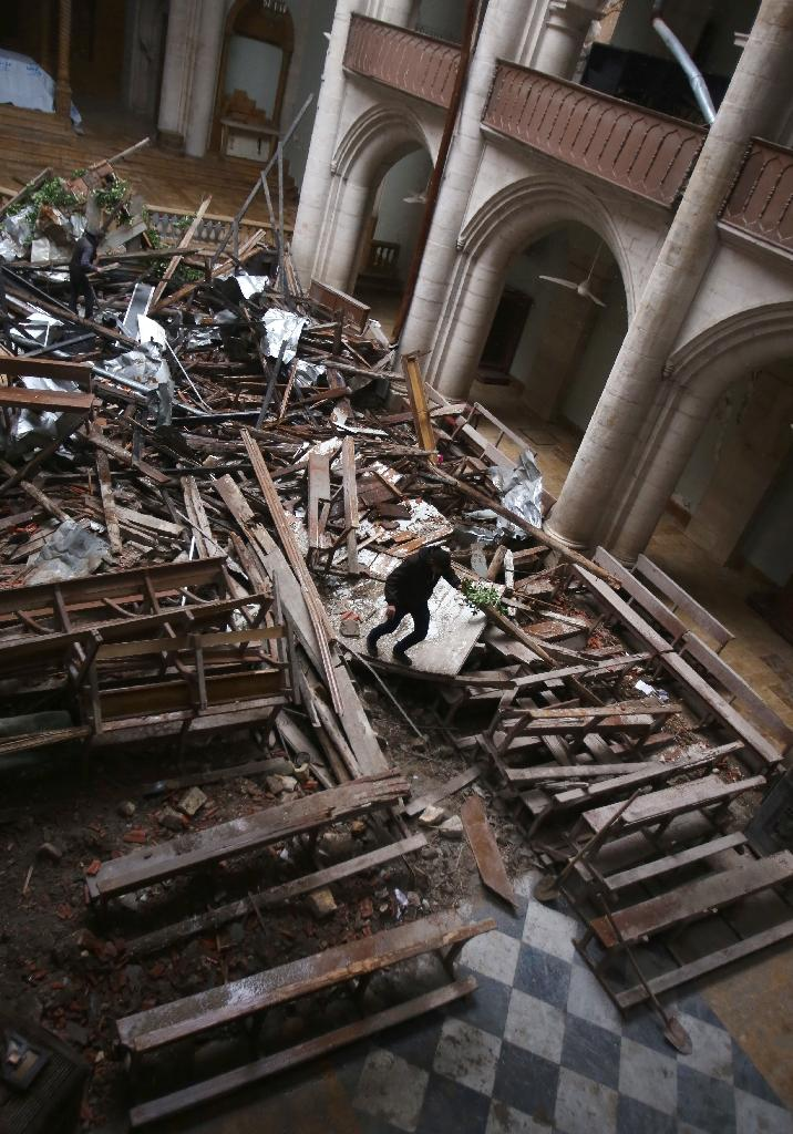 Debris inside east Aleppo's Saint Elias Cathedral (AFP Photo/Youssef KARWASHAN)