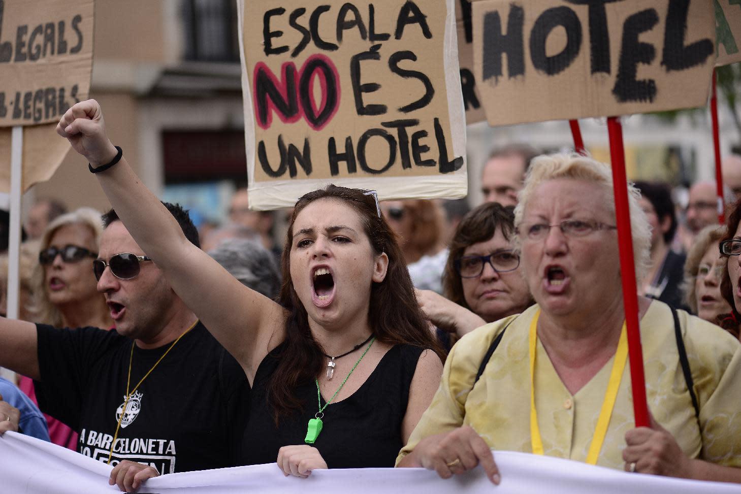 Barcelona locals rebel at drunken, naked tourist high jinks