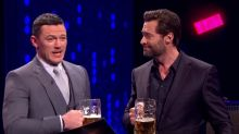 Watch Hugh Jackman and Luke Evans Try to Out-Gaston Each Other