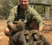 Calls for Idaho wildlife official to resign after baboon hunting picture surfaces