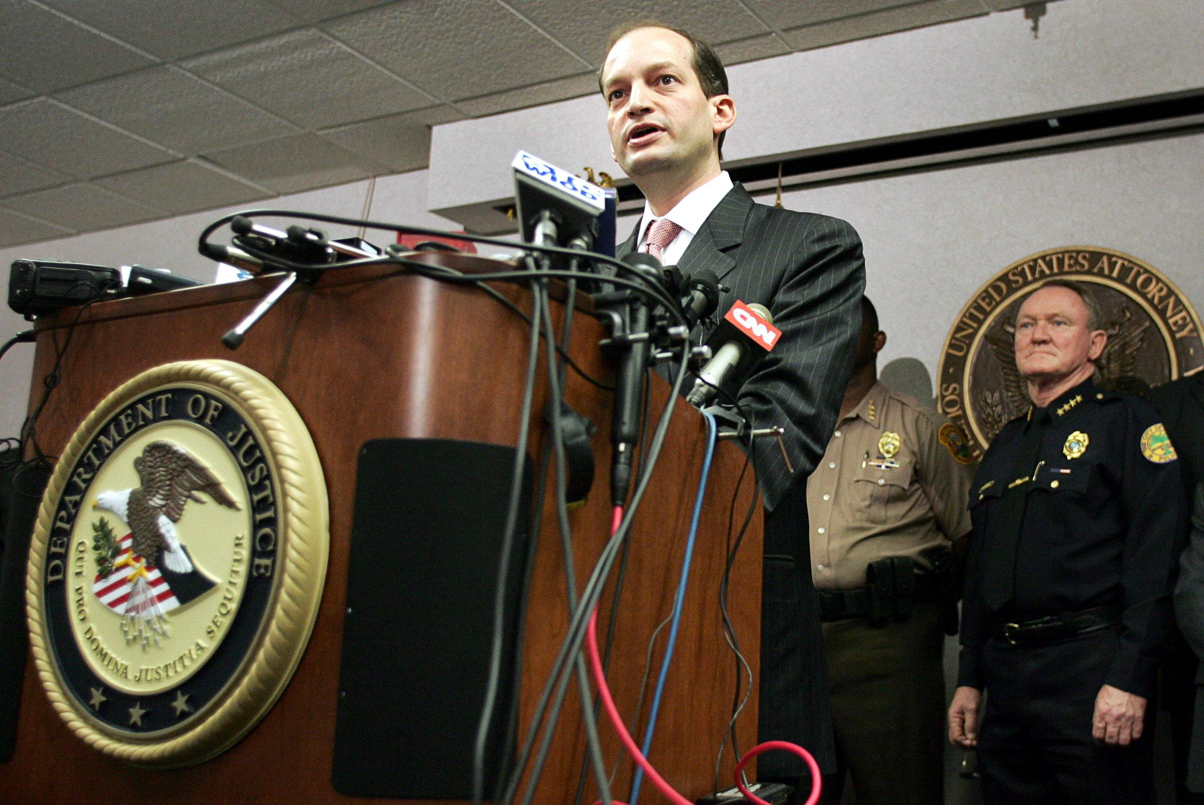 File Photo: U.S. Attorney R. Alexander Acosta (L) and other law enforcement officials hold a news conference in Miami, Florida, June 23, 2006.REUTERS/Marc Serota/File Photo