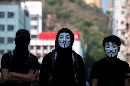 Thousands of Hong Kong protesters march in defiance of mask ban