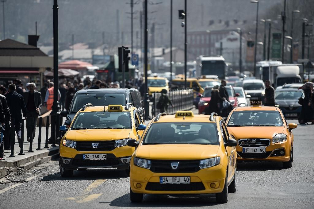 """Official yellow taxis wait for customers in Istanbul where President Recep Tayyip Erdogan says rival ride-app Uber is """"finished"""""""