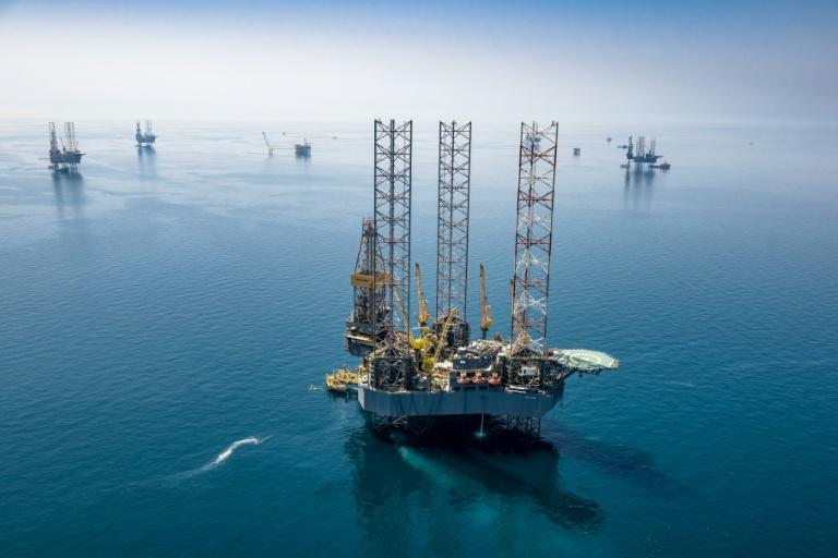A handout picture provided Saudi Aramco shows its rigs in HSBH field north of Dhahran in 2018