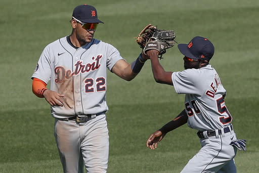 Detroit Tigers center fielder Victor Reyes (22) and right fielder Travis Demeritte celebrate after defeating the ]Pittsburgh Pirates in a baseball game, Sunday, Aug. 9, 2020, in Pittsburgh. (AP Photo/Keith Srakocic)