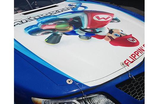 Mario rides the hood of NASCAR driver Matt Kenseth
