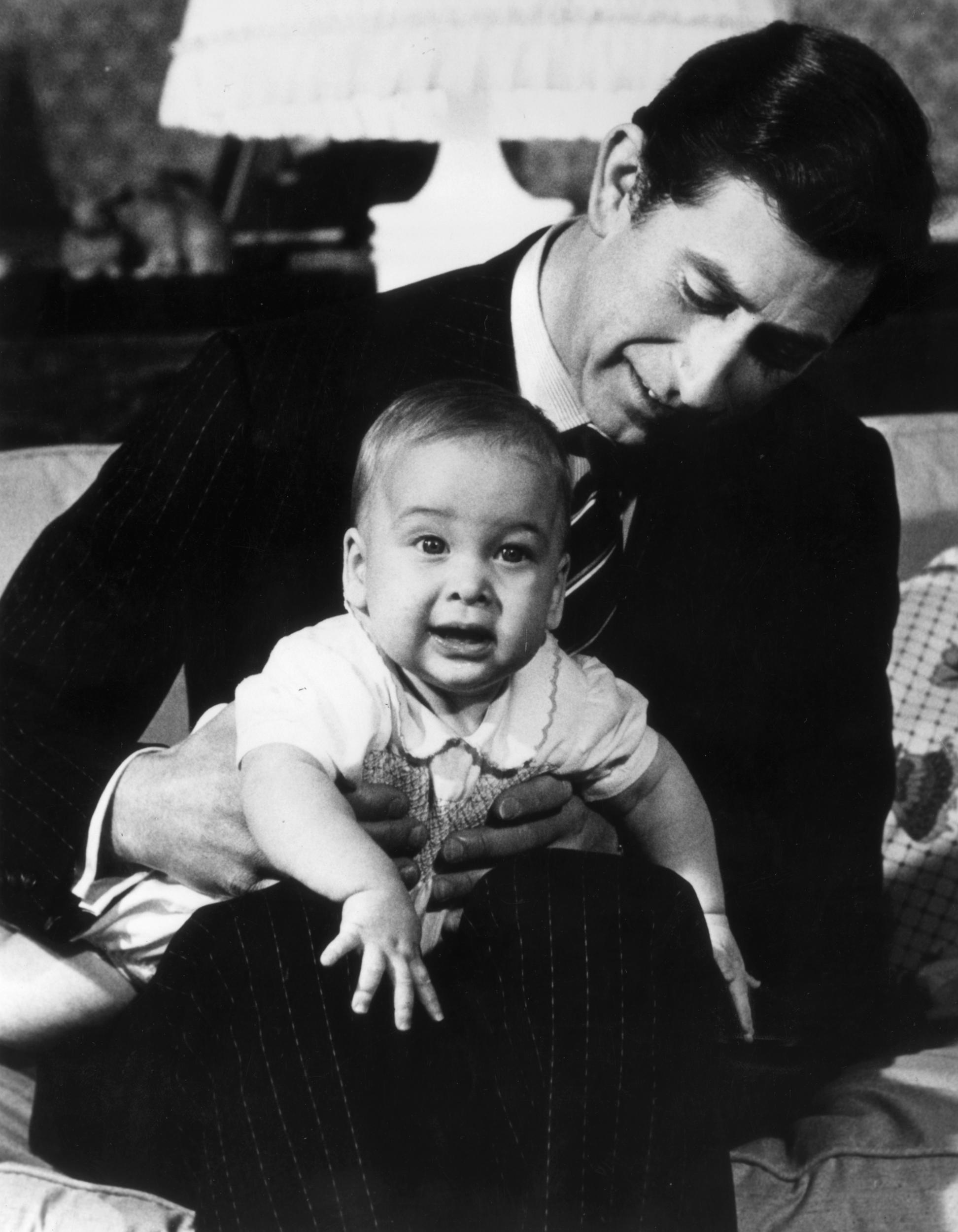 22nd December 1982:  Prince Charles with his baby son, Prince William at Kensington Palace, London.  (Photo by Keystone/Getty Images)