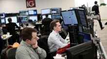 FTSE 100 retreats as insurers, Tesco take hit