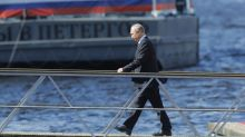 Putin attends naval parade, promises new ships to navy
