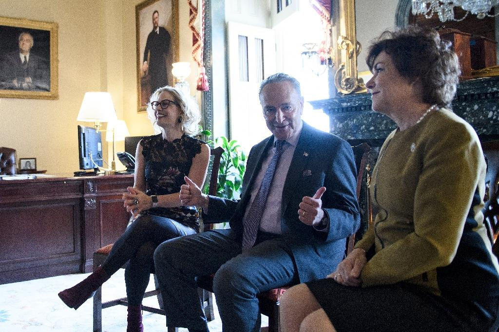 US Senate Minority Leader Chuck Schumer, center, meets with Democratic senators-elect Kyrsten Sinema of Arizona, left, and Jacky Rosen of Nevada in his US Capitol office on November 13, 2018